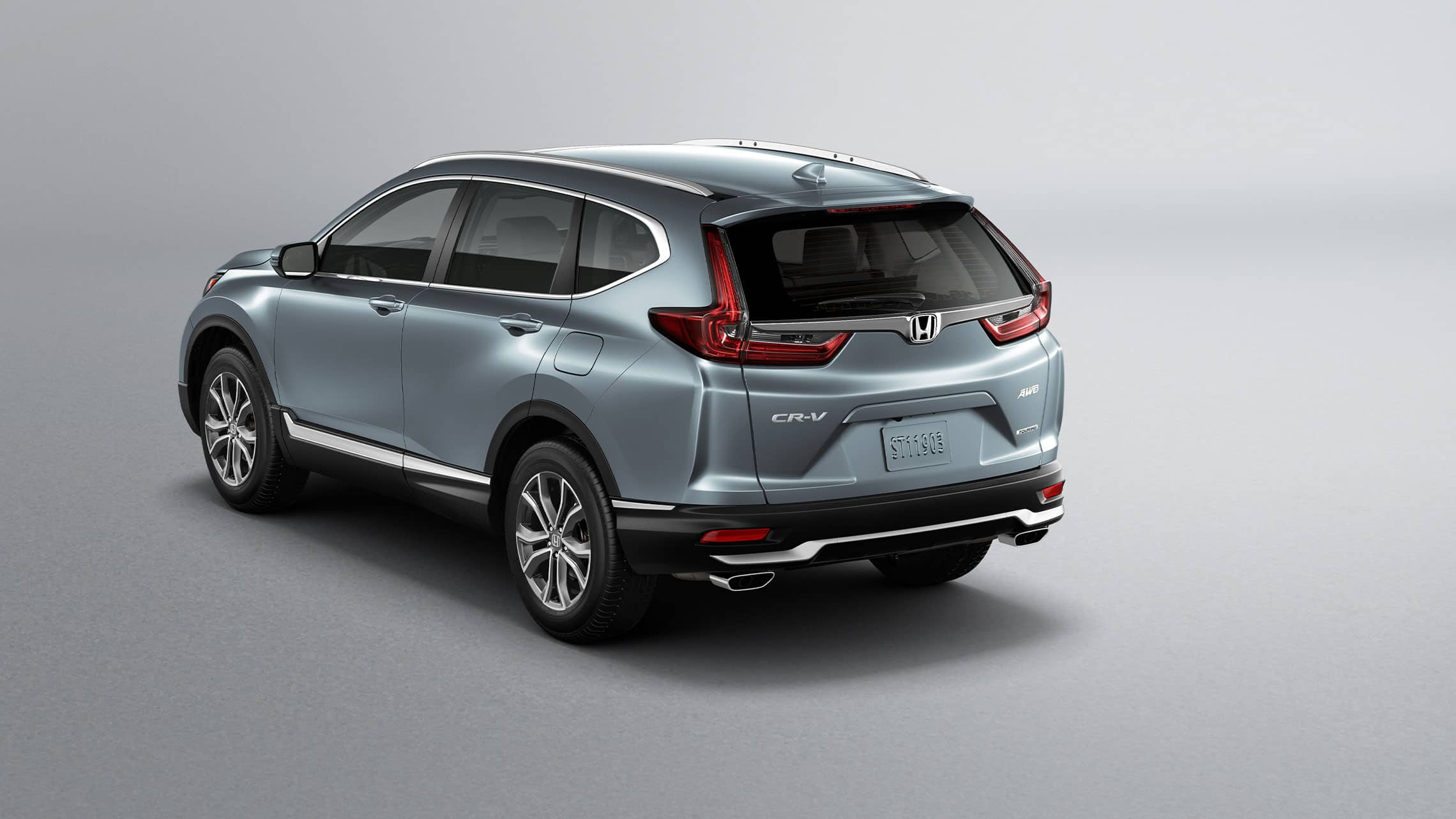Rear driver-side view of the 2020 Honda CR-V Touring in Sonic Gray Pearl showing LED taillights.