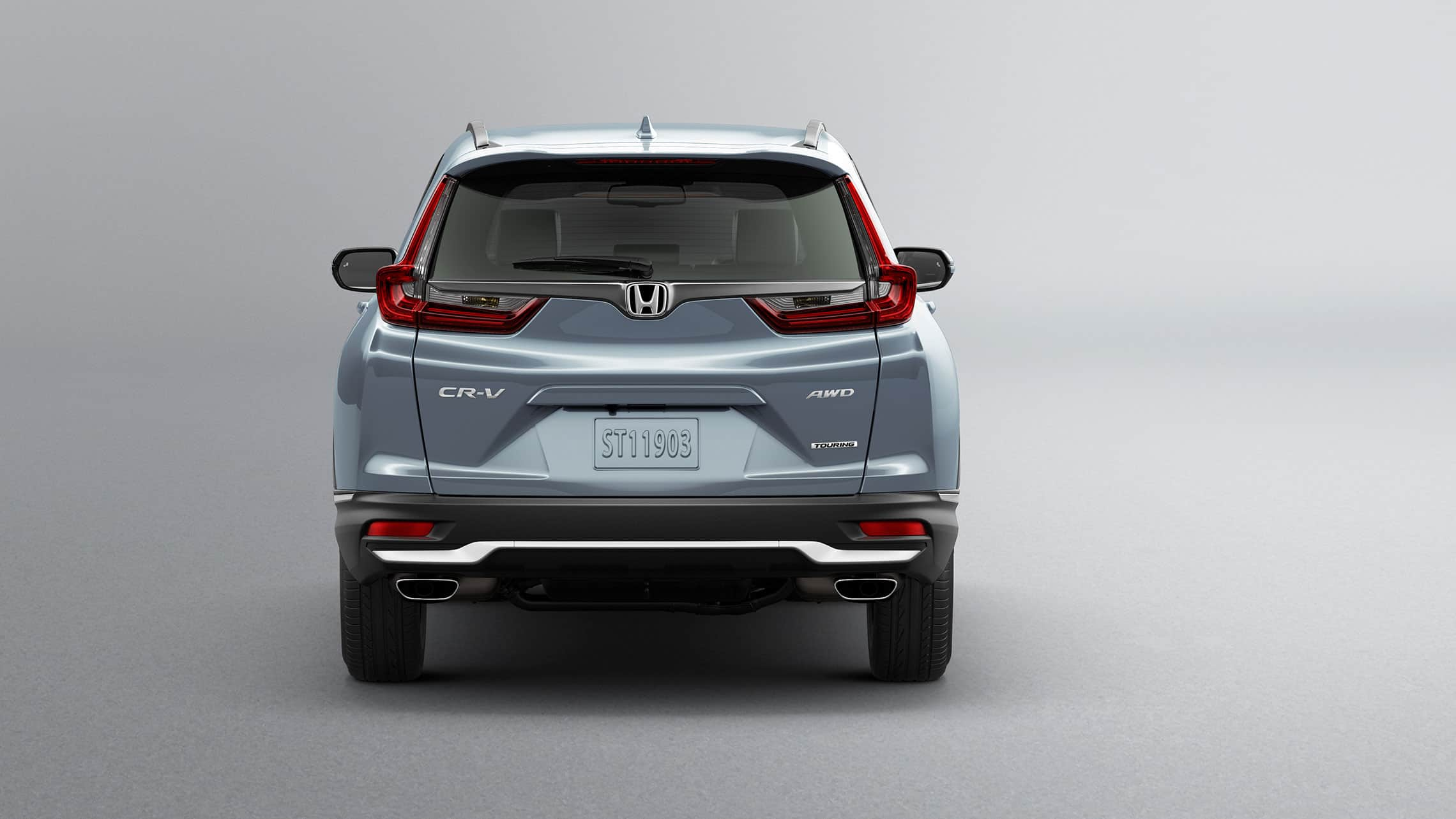 Rear view of 2020 Honda CR-V Touring in Sonic Gray Pearl showing dual chrome exhaust finishers.