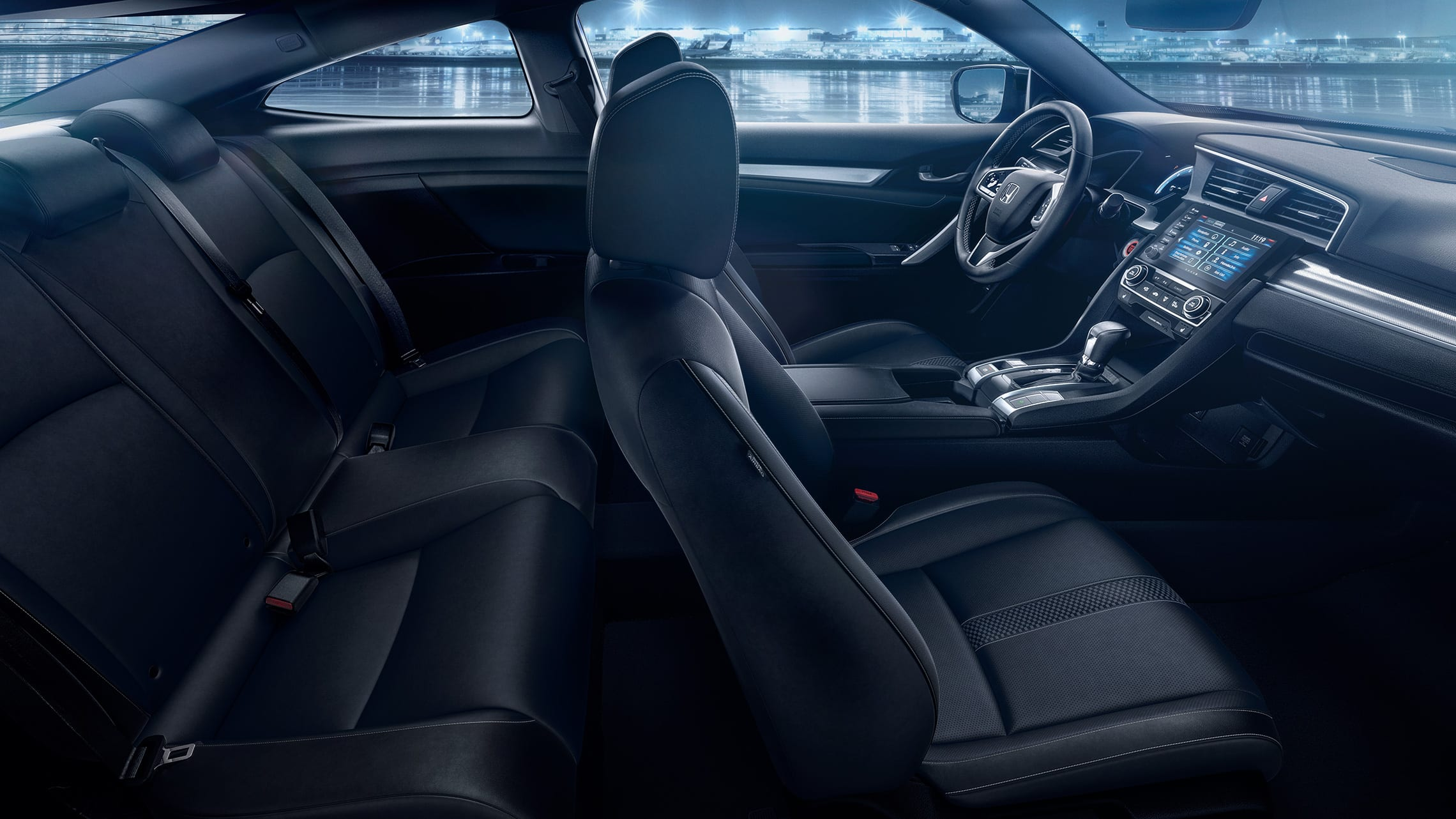 Interior passenger-side view of front and back seats in the 2020 Honda Civic Touring Coupe with Black Leather.